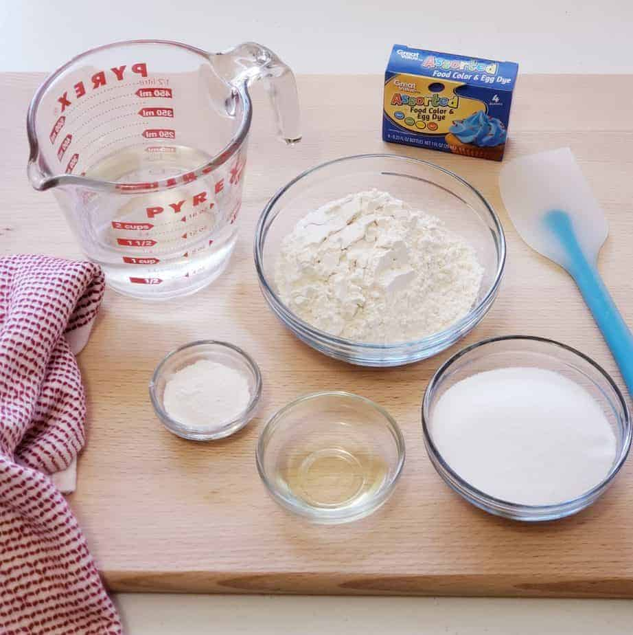 ingredients for homemade play dough: water, flour, salt, oil, cream of tartar, food coloring